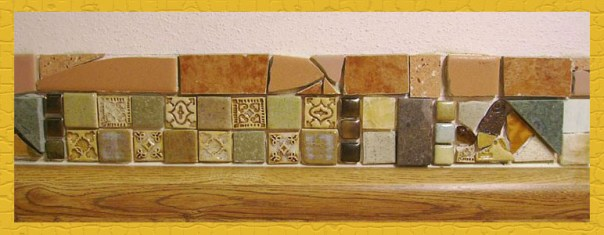 Tile strip in my kitchen made from handmade tiles, purchased tiles, and salvaged tiles.