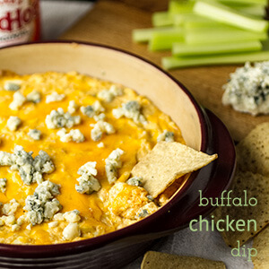 Quick Buffalo chicken dip is ready in less than thirty minutes and it's sure to be a hit with all the guests at your next party!   recipe from Chattavore.com