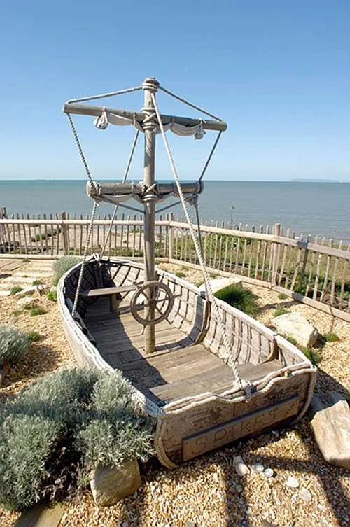 can serve as a sandbox and becomes a pirate ship with a mast and ships