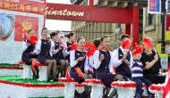 Quinn and Rauner March in China's National Day Parade