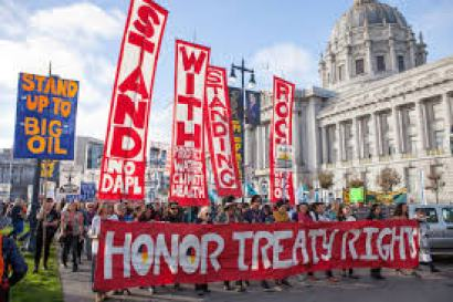 People protesting the Dakota Access Pipeline march past San Francisco City Hall. Photo courtesy: Pax Ahimsa Gethen (Own work) [CC BY-SA 4.0 (http://creativecommons.org/licenses/by-sa/4.0)], via Wikimedia Commons