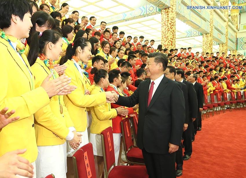Líderes chinos se reúnen con delegación olímpica