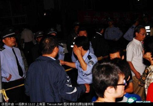 Police try to maintain order as a large crowd of Chinese students protest Japanese students in Shanghai.