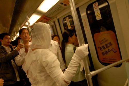 Shanghai subway mummy prepares to get off the metro.