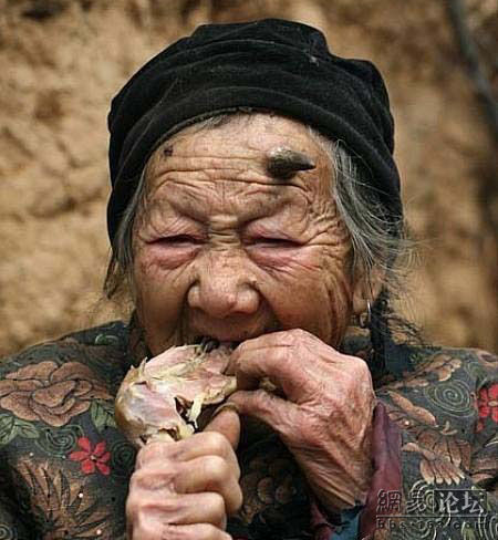 Horned granny eating a chicken leg.
