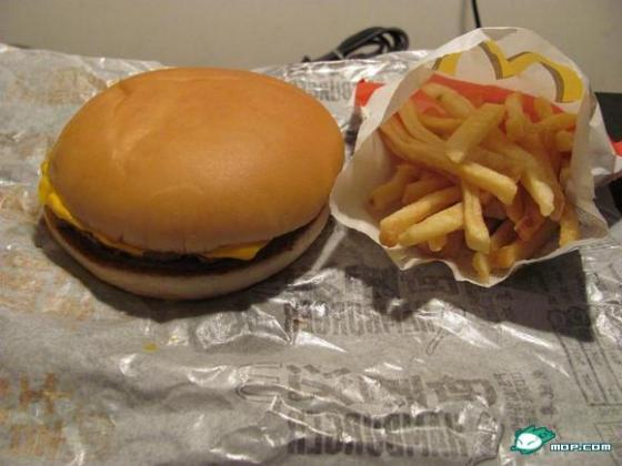 A McDonald's Cheeseburger Happy Meal with small fries.