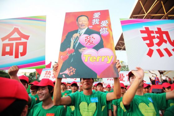 Foxconn China workers holding up a sign expressing their love for Terry Guo.
