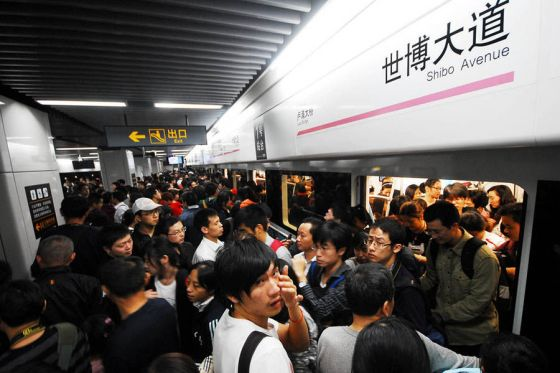 Visitors to the Shanghai World Expo entering through the metro.
