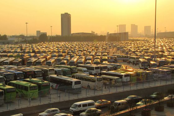 Sunset over a Shanghai World Expo parking lot filled with tour buses.