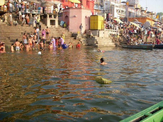 Indians bathing by the side of the Ganges River.