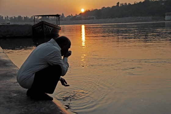 Man drinks from the Ganges River.
