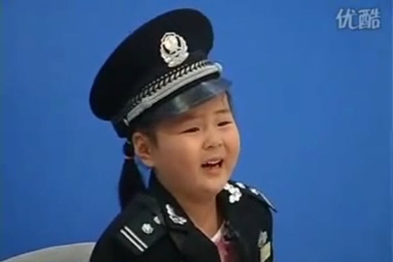 A scared little Chinese girl cries on a Jiangsu Television show.