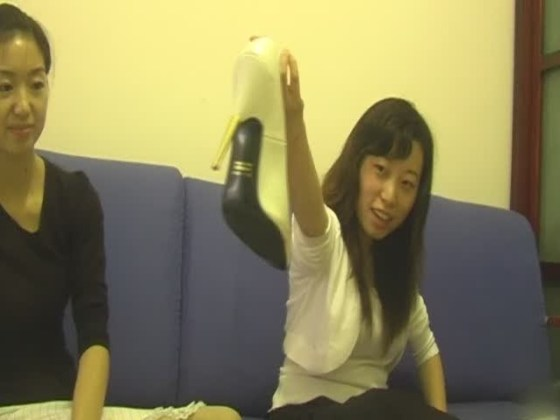 Chinese girls showing off the high heels they use to crush rabbits and kittens in crush fetish videos.