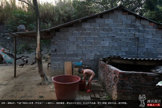 Chinese AIDS orphan A-Long bathing himself.