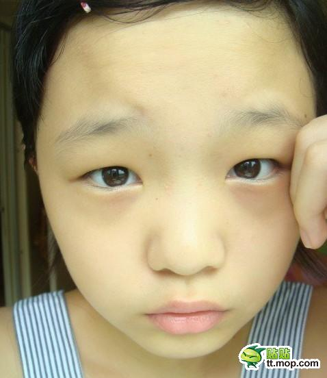 12-year-old Chinese girl shows how she applies her make-up.