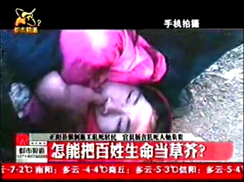 The woman passes away as rescuers try to save her.