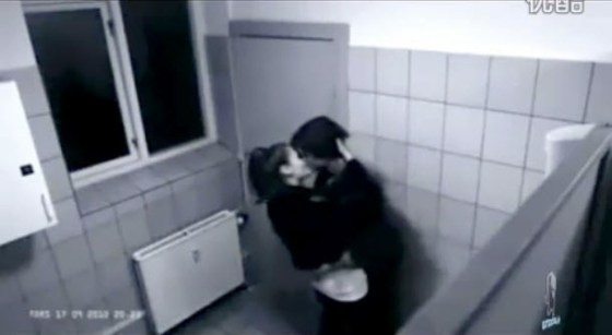 Two teenagers caught on a surveillance camera in a toilet passionately kissing.