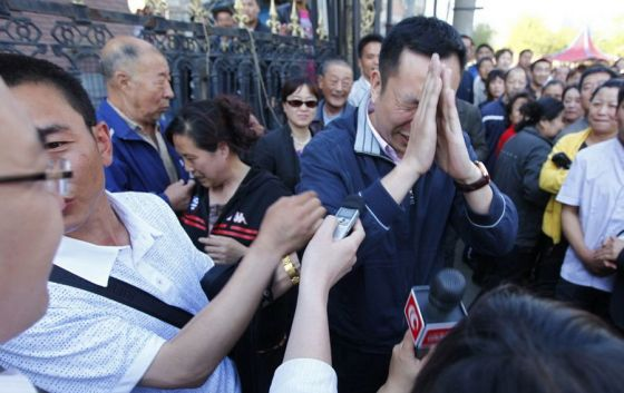 Guo Zhongfan, the local government official whose quick reaction helped save the girl in the wedding dress.