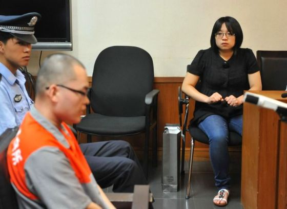 A Peking University graduate stands trial in Beijing after strangling a 11-year-old boy.