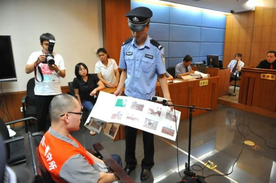In Beijing, Lian Yong stands trial after strangling a 11-year-old boy and then extorting the child's family.