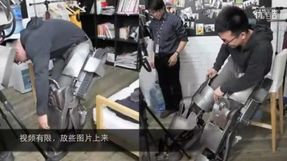 A Chinese person putting on the Iron Man MK I armor he has recreated.