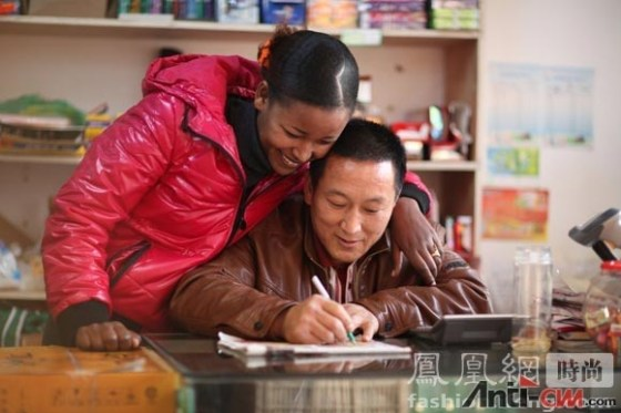 A Chinese and African couple.