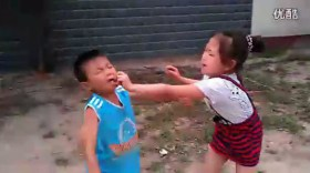 The little girl grabbing and clawing at the litle boy's face.