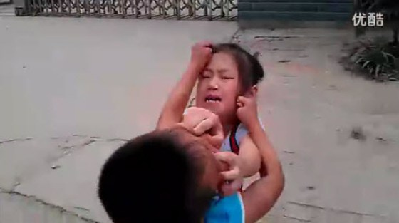 The two Chinese children, cousins, pulling at each other's hair, clawing at each other's faces.