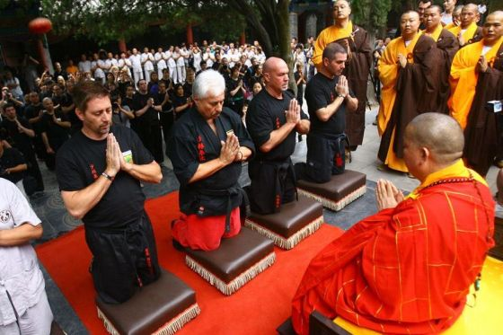 US Shaolin Fist Union students paying their respects to Abbot Shi Yongxin on a pilgrimage to the Shaolin Temple in China.