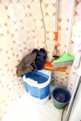 A space for house cleaning tools in a Kunming mobile home.