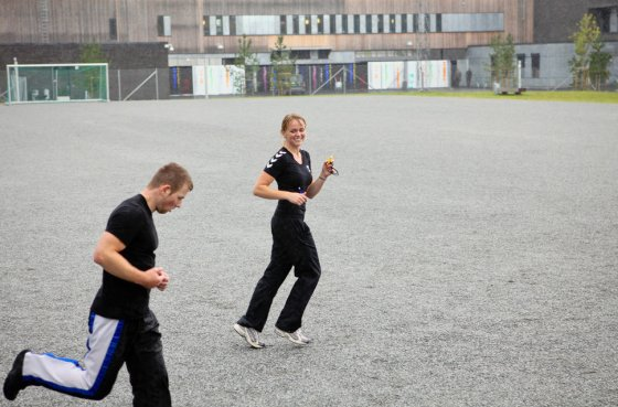 A woman trainer (right) is running alongside an inmate in the yard of the luxurious Halden Fengsel, (prison) during the time prisoners regularly spend carrying out physical exercise and learning about the human body in Halden, near Oslo.