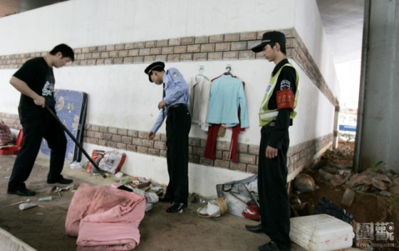 Shenzhen police clearing out the drug users from their home under the overpass.