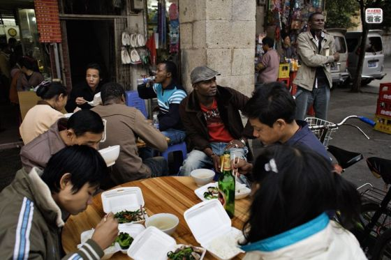 Africans and Chinese at a street-side food stall.