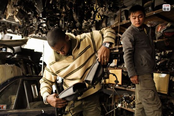 Nelson, a Nigerian in Guangzhou, looks at some motorcycle parts.