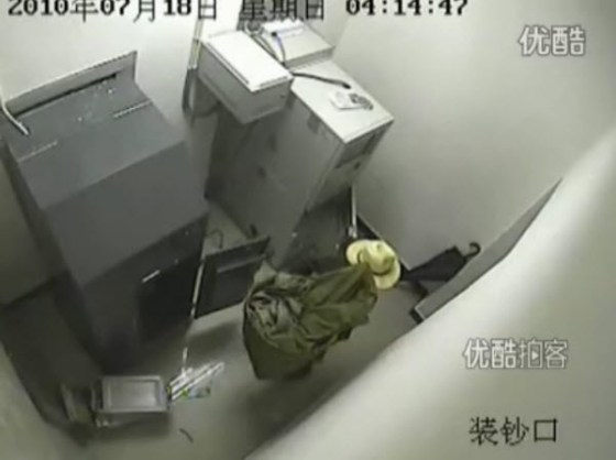"Chinese ""Straw Hat Burglar"" leaving with over 500k RMB in cash stolen from the ATM machine."