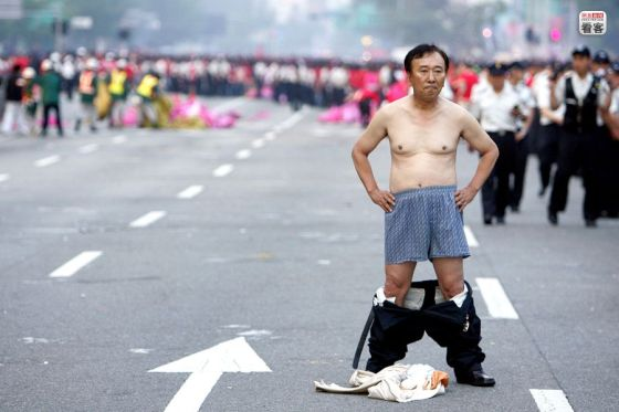 A Korean football fan drops his trousers to show his displeasure during the 2006 World Cup.