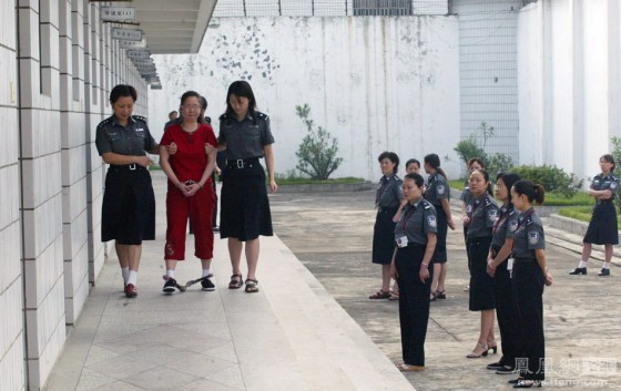 Female prison guards in a line to send off their condemned prisoners.