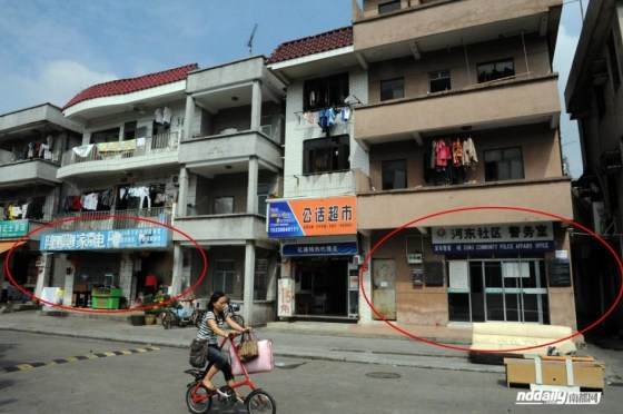 Yang's electronic appliances repair shop was only meters away from the local community police station.