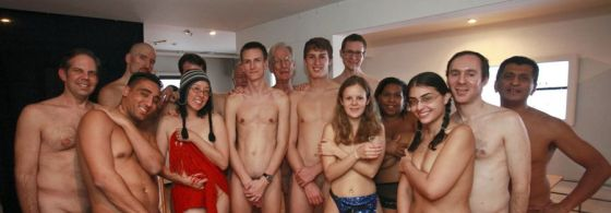 Group photo of Americans at a nudism party in New York.