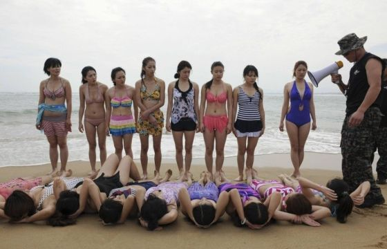 Chinese girls in swimsuits training to be professional female bodyguards.