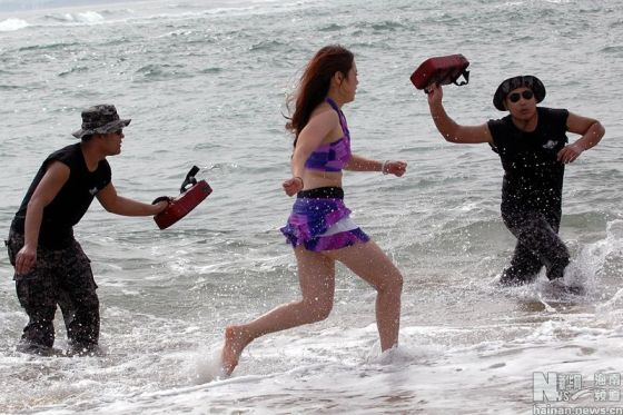 Chinese female bodyguards in swimsuits training on a beach in Hainan, China.