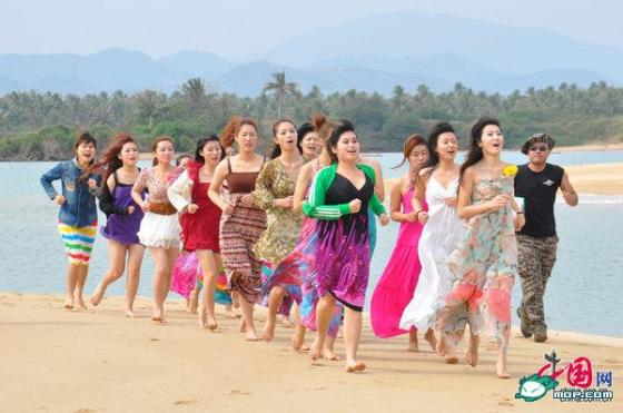 A group of Chinese female bodyguards training on a beach in Hainan, China.