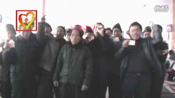 A group of Chinese migrant workers who have gotten their train tickets and are on their way home to celebrate Chinese New Years with their families.