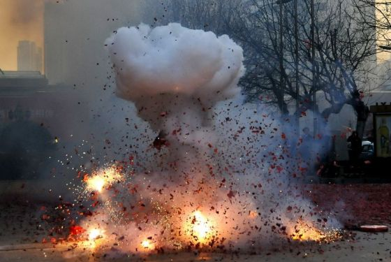 Exploding firecrackers in China during Chinese New Year celebrations.