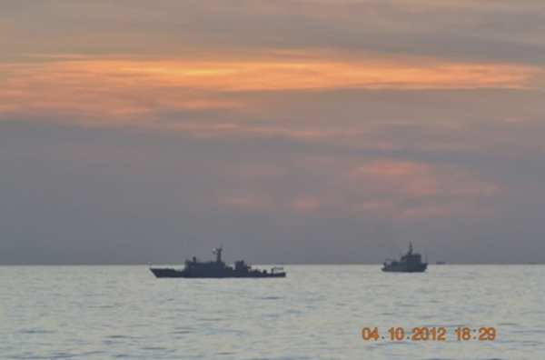 Chinese surveillance ships intercept and stand off against a Philippine warship near Scarborough Shoal in the South China Sea.