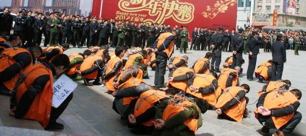 A Henan city in China tries 51 criminal suspects in public.