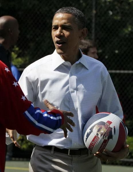 Obama is shaking hand with another player.