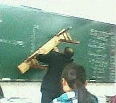 A Chinese teacher using a wooden bench to teach geometry.