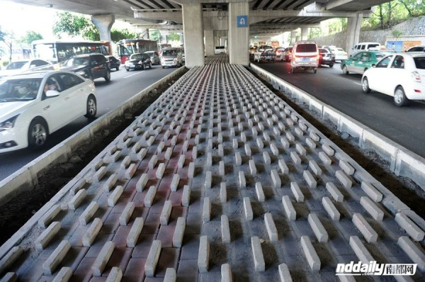 Pyramid shaped cement blocks placed underneath overpasses in Guangzhou and Shenzhen, China, possibly to discourage homeless from sleeping under them.