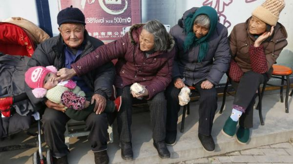 Elderly Chinese with a baby.